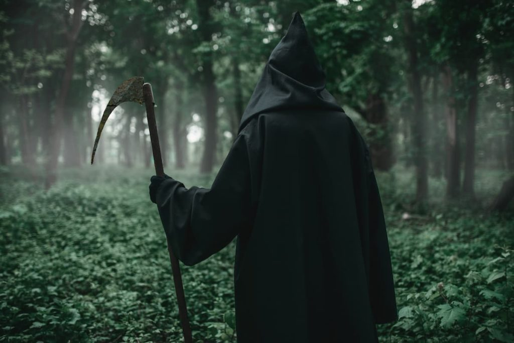 Grim reaper walking in the forest with father time