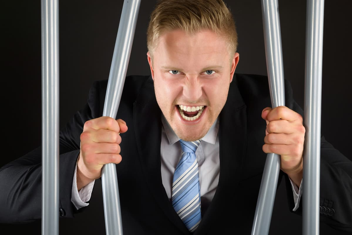 Angry father bending metal bars showing his strength